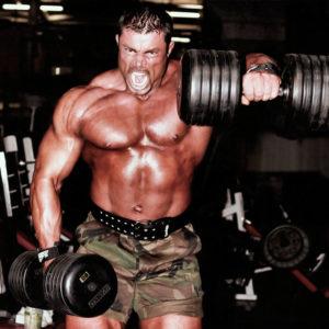 Подъем гантелей перед собой стоя: техника и задействованные мышцы